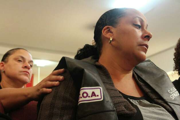 Cecilia Reyes, right, is comforted during the funeral service for her son Noel Polanco Friday Oct. 12, 2012 at the Eternal Love Baptist Church in the Queens borough of New York.  Polanco, a 22-year-old Army National Guardsman, was fatally shot by New York City police when he was pulled over for a traffic violation on Oct. 4 near LaGuardia Airport. (AP Photo/Tina Fineberg) Photo: Tina Fineberg