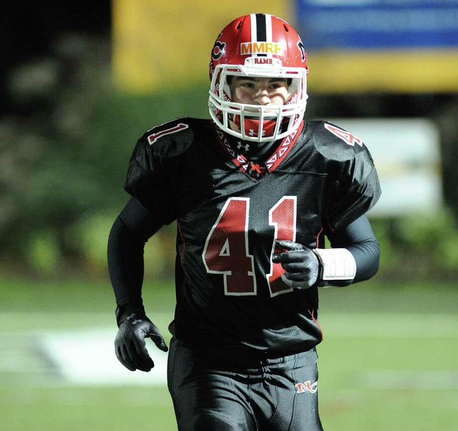 Running back Frank Cognetta # 41 of New Canaan after scoring a second quarter running touchdown during the High School football game between New Canaan High School and Norwalk High School at New Canaan, Friday night, Oct. 12, 2012. Photo: Bob Luckey / Greenwich Time