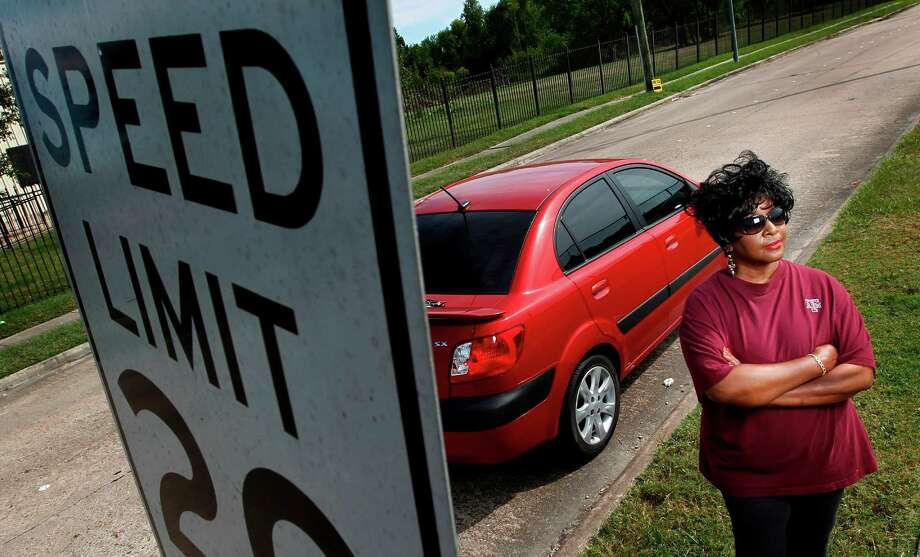 Shirley Simmons, who was ticketed for speeding in a school zone, was surprised to find two additional violations on her citation. She had not committed either offense. Photo: Mayra Beltran / © 2012 Houston Chronicle