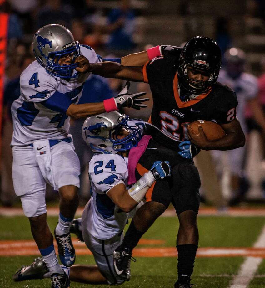 Texas City 63, Friendswood 35Texas City running back Deshaun Rawls gets tackled by Friendswood defensive back Josh Camarillo and linebacker James Bauer. Photo: Andrew Richardson, For The Chronicle / © 2012 Andrew Richardson