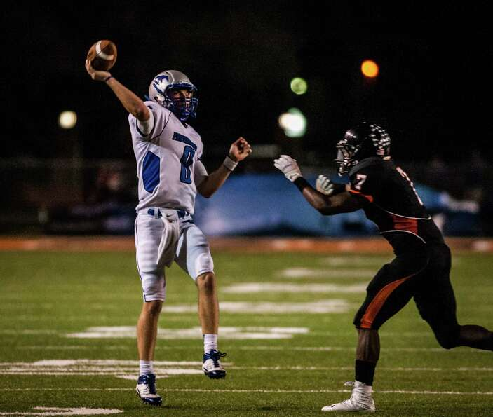 Friendswood quarterback Jordan Wood throws across his body for a touchdown during the second quarter