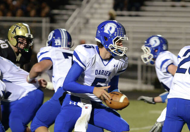 Darien's quarterback Henry Baldwin (5) makes a handoff during the football game against Trumbull at Trumbull High School on Friday, Oct. 12, 2012. Photo: Amy Mortensen / Connecticut Post Freelance