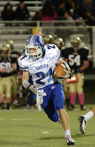 Darien's Nicholas Lombardo (21) carries the ball during the football game against Trumbull at Trumbull High School on Friday, Oct. 12, 2012. Photo: Amy Mortensen / Connecticut Post Freelance