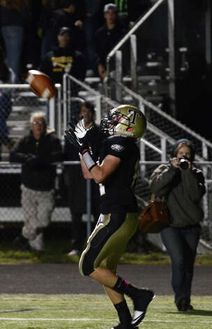 Trumbull's Daniel Paolino (11) receives a touchdown pass during the football game against Darien at Trumbull High School on Friday, Oct. 12, 2012. Photo: Amy Mortensen / Connecticut Post Freelance