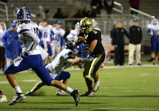 Trumbull's Ryan Pearson (2) avoids a tackle by Darien during the football game at Trumbull High School on Friday, Oct. 12, 2012. Photo: Amy Mortensen / Connecticut Post Freelance