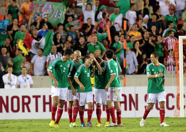 Mexico celebrates after Andrés Guardado, 18, scored a goal during the second half of the FIFA World Cup qualifying match against Guyana at BBVA Compass Stadium Friday, Oct. 12, 2012, in Houston. Mexico won 5-0. Photo: Cody Duty, Houston Chronicle / © 2012 Houston Chronicle