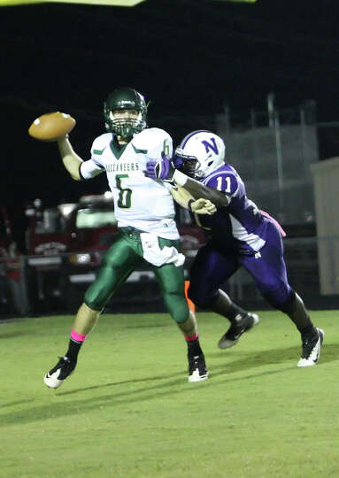 East Chambers quarterback Brandon Johnson, 6, is pressured by Newton s Anthony Hadnot during the gam