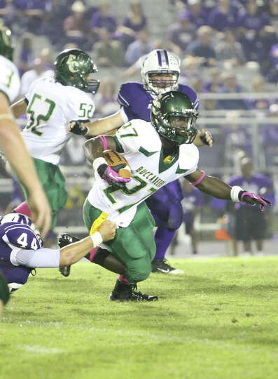 East Chambers running back Glenn Roberts, 27, is dragged down by Newton's Corey Jenkins during the g