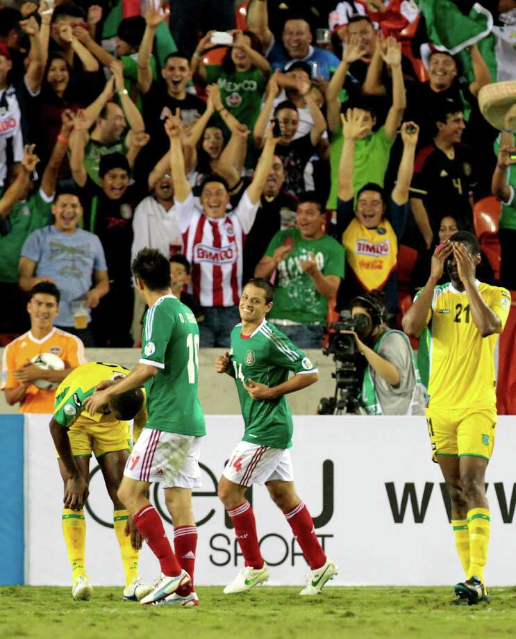 Mexico's Javier Hernandez, 14, reacts after scoring a goal during the second half of the FIFA World Cup qualifying match against Guyana at BBVA Compass Stadium Friday, Oct. 12, 2012, in Houston. Mexico won 5-0. Photo: Cody Duty, Houston Chronicle / © 2012 Houston Chronicle