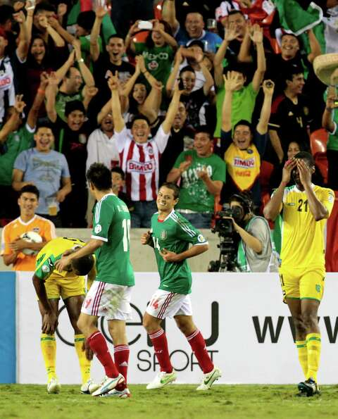 Mexico's Javier Hernandez, 14, reacts after scoring a goal during the second half of the FIFA World