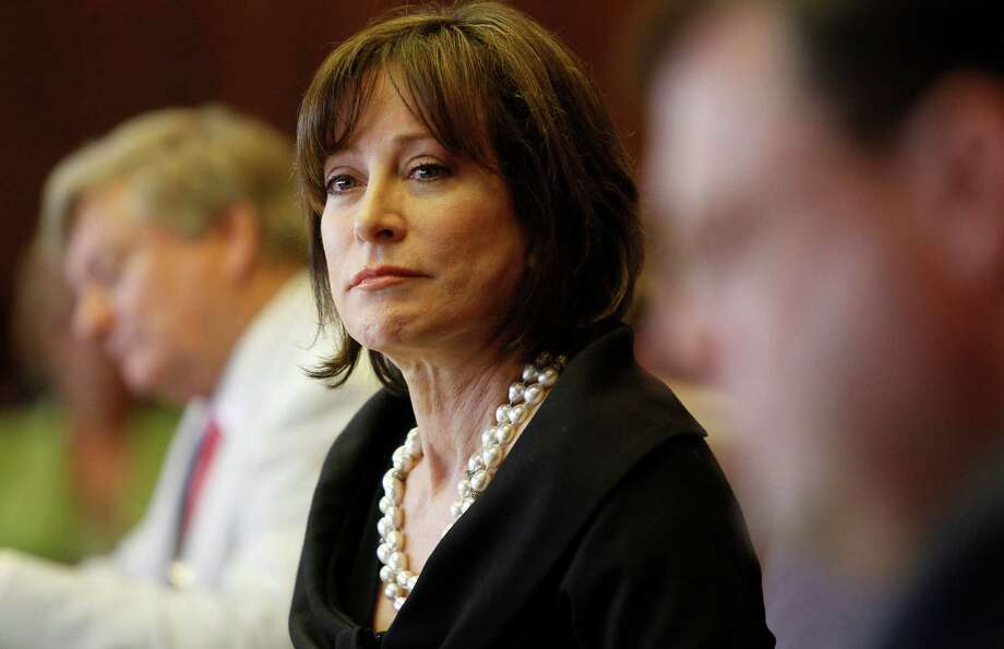 Commissioner Janiece Longoria listens to a speaker during the Port Commission meeting as Port Commissioners discuss the future of Port CEO Alec Dreyer, Tuesday, May 24, 2011, in Houston. There's been criticism of his actions lately. ( Karen Warren / Houston Chronicle ) Photo: Karen Warren / © 2011 Houston Chronicle