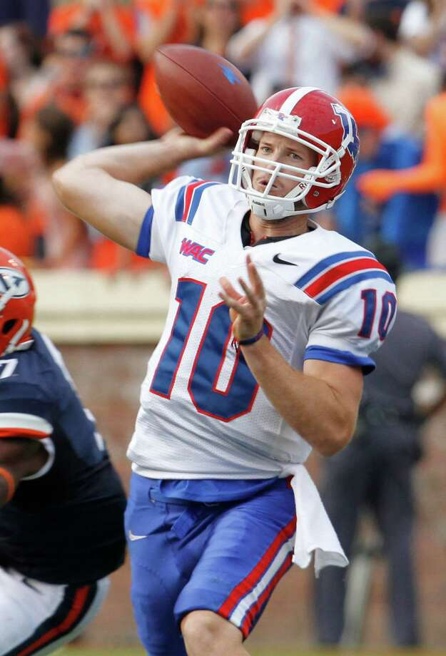 Louisiana Tech quarterback Colby Cameron (10) throws a pass during the first half of an NCAA college football game at Scott stadium in Charlottesville, Va., Saturday, Sept. 29, 2012.   (AP Photo/Steve Helber) Photo: Steve Helber / AP