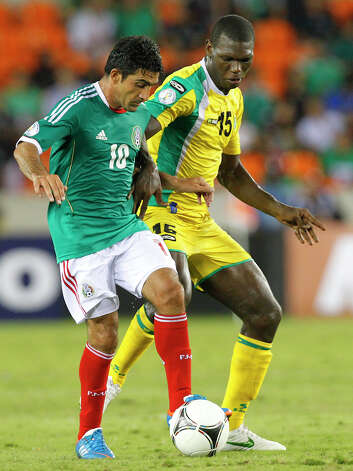Mexico's Antonio Matias left, takes possession from a Guyana defender during the second half of their FIFA World Cup qualifying match at BBVA Compass Stadium Friday, Oct. 12, 2012, in Houston. Mexico won 5-0. Photo: Cody Duty, Houston Chronicle / © 2012 Houston Chronicle