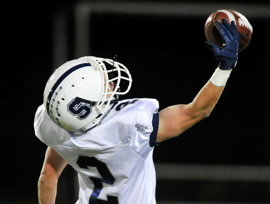 Staples' Will Johnson unsuccessfully attempts a one-handed catch during their game at Danbury High School on Friday, Oct. 12, 2012. Staples won, 51-6. Photo: Jason Rearick / The News-Times