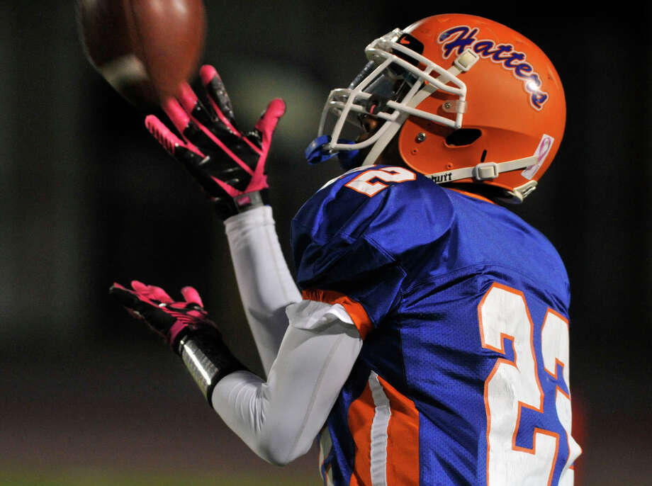 Danbury's Tysheen McCrea fields a punt return during their game against Staples at Danbury High School on Friday, Oct. 12, 2012. Staples won, 51-6. Photo: Jason Rearick / The News-Times