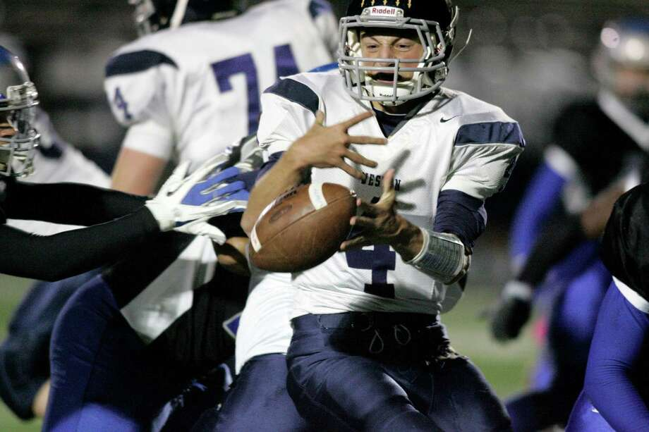 Senior quarterback Tyler Hassett fumbles the ball during second half action at Bunnell High School on Friday evening in Stratford. Bunnell led by a few long runs and receptions and opened up to a 18-7 halftime margin  © J. Gregory Raymond Photo: J. Gregory Raymond / Stamford Advocate Freelance;  © J. Gregory Raymond