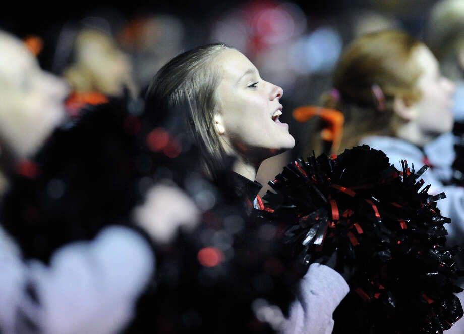 New Canaan High School cheerleader Bridget Callahan cheers during the high School football game between New Canaan High School and Norwalk High School at New Canaan, Friday night, Oct. 12, 2012. Photo: Bob Luckey / Greenwich Time
