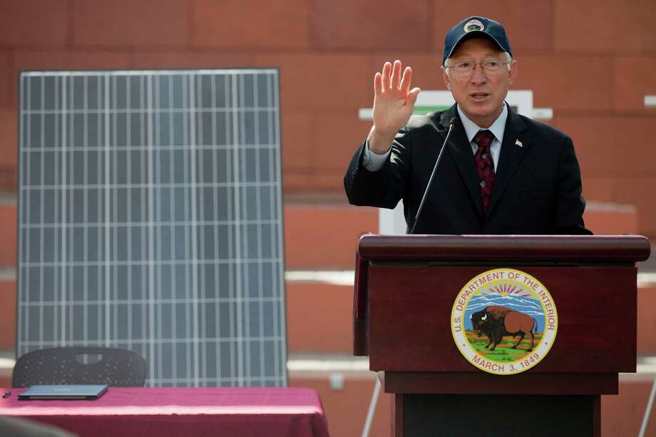 """Interior Secretary Ken Salazar speaks during a news conference, Friday, Oct. 12, 2012, in Las Vegas, in which he and Senate Majority Leader Harry Reid announced a plan that sets aside 285,000 acres of public land for the development of large-scale solar power plants. The government is establishing 17 new """"solar energy zones"""" on 285,000 acres in six states: California, Nevada, Arizona, Utah, Colorado and New Mexico. Most of the land,153,627 acres, is in Southern California. (AP Photo/Julie Jacobson). Photo: Julie Jacobson / AP"""