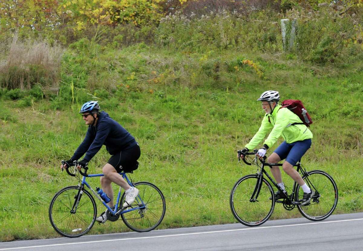 Nobel Prize-winning South African novelist J.M. Coetzee, right,, a cycling enthusiast, takes a bicycle ride through the Capital Region with UAlbany English professor Richard Barney in Albany, NY Friday Oct. 12, 2012. (Michael P. Farrell/Times Union)