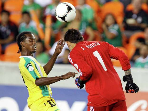 Guyana's Gregory Richardson, left, nearly collides with Mexico goalie Jonathan Orozco ,right, during the second half of the FIFA World Cup qualifying match against Guyana at BBVA Compass Stadium Friday, Oct. 12, 2012, in Houston. Mexico won 5-0. Photo: Cody Duty, Houston Chronicle / © 2012 Houston Chronicle