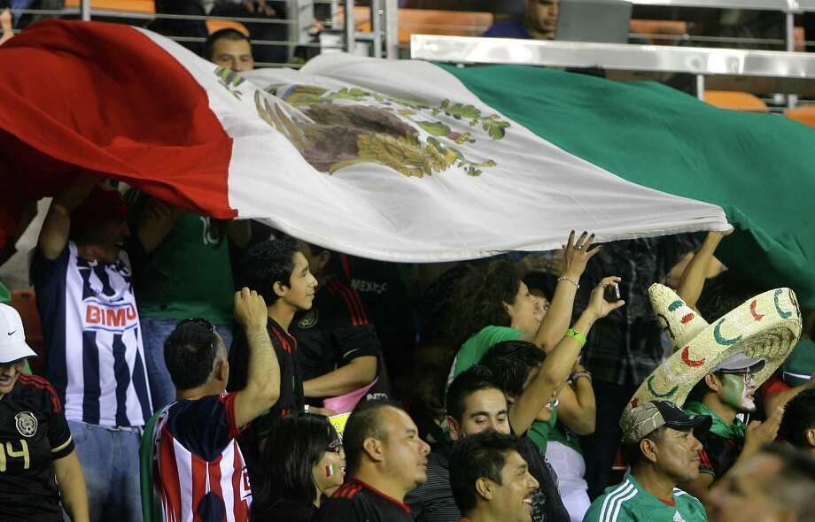 Mexico fans wave a flag during the second half of the FIFA World Cup qualifying match against Guyana at BBVA Compass Stadium Friday, Oct. 12, 2012, in Houston. Mexico won 5-0. Photo: Cody Duty, Houston Chronicle / © 2012 Houston Chronicle