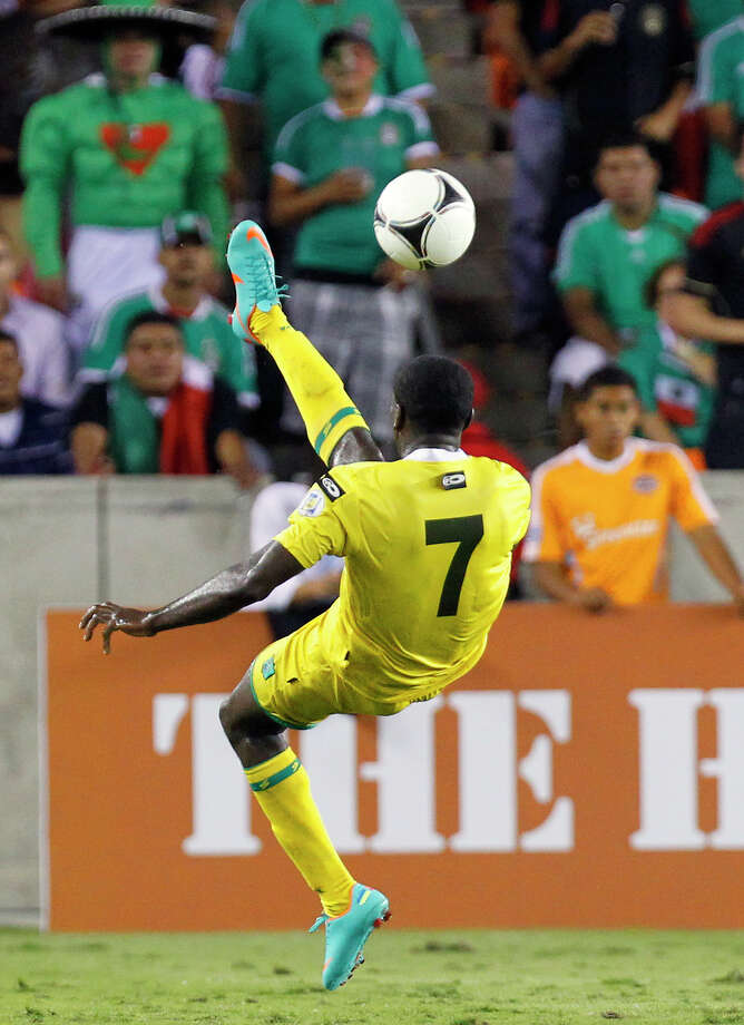 Guyana's Dwain Jacobs attempts a bicycle kick in the second half. Photo: Cody Duty, Houston Chronicle / © 2012 Houston Chronicle