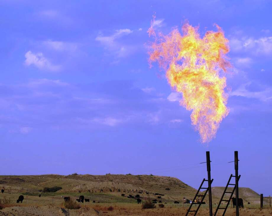 A drilling boom has transformed parts of North Dakota, making natural gas flares like this near Trenton a common sight. Photo: Kevin G. Hall, STF / MCT