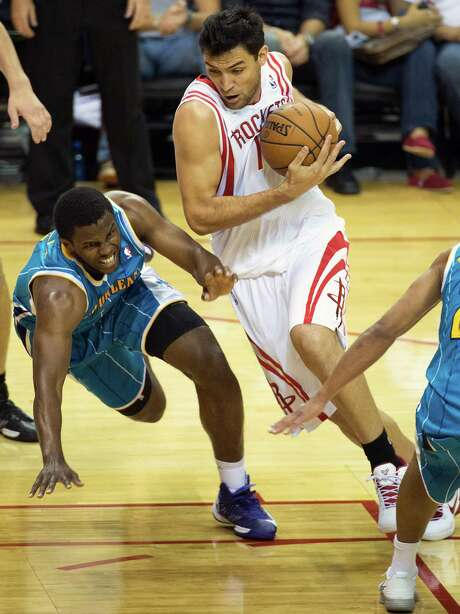 Carlos Delfino, right, is one of the Rockets' options who could pair at guard with Shaun Livingston. Photo: Smiley N. Pool / © 2012  Houston Chronicle