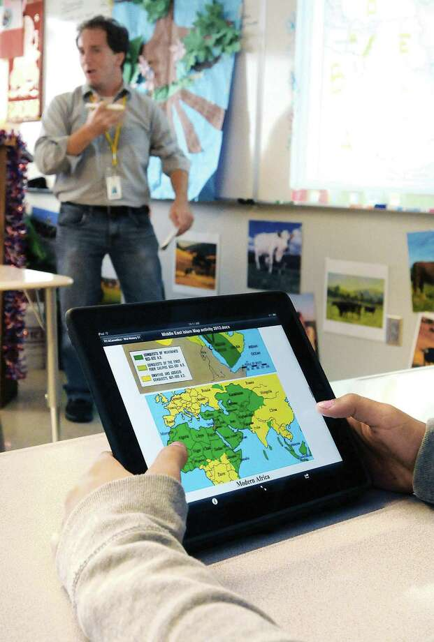 A student follows along on her iPad during a review for a test in Garden City, Kan. Photo: BECKY MALEWITZ / GARDEN CITY TELEGRAM