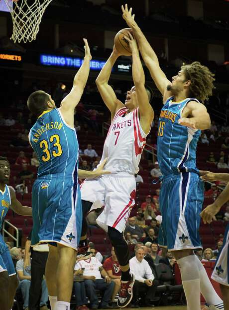 Jeremy Lin, center, was part of a Rockets effort that saw defense translate into being a step quicker on offense than the Hornets. Photo: Smiley N. Pool / © 2012  Houston Chronicle