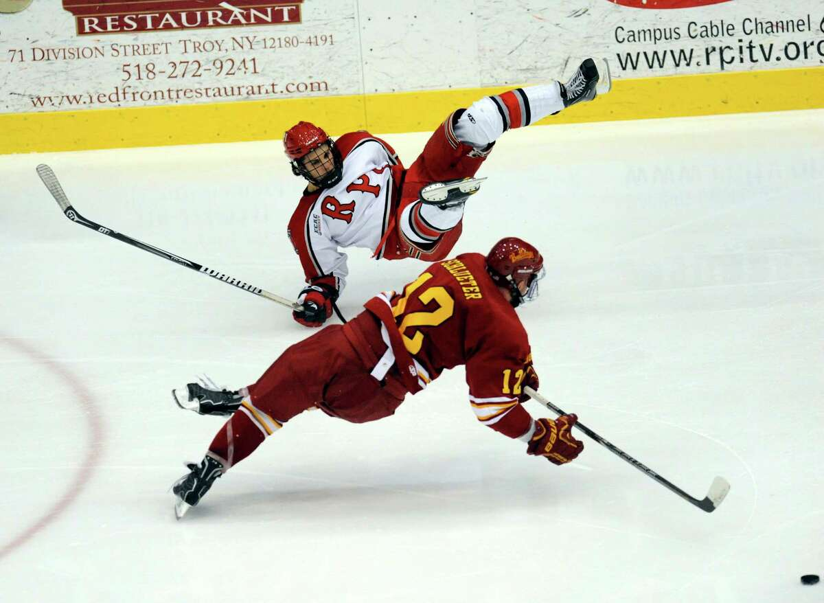 Rensselaer Polytechnic Institute's Johhy Rogic ,top, and Ferris State's TJ Schlueter collide during their college hockey game in Troy N.Y., Friday, Oct. 12, 2012. (Hans Pennink / Special to the Times Union) College Sports.