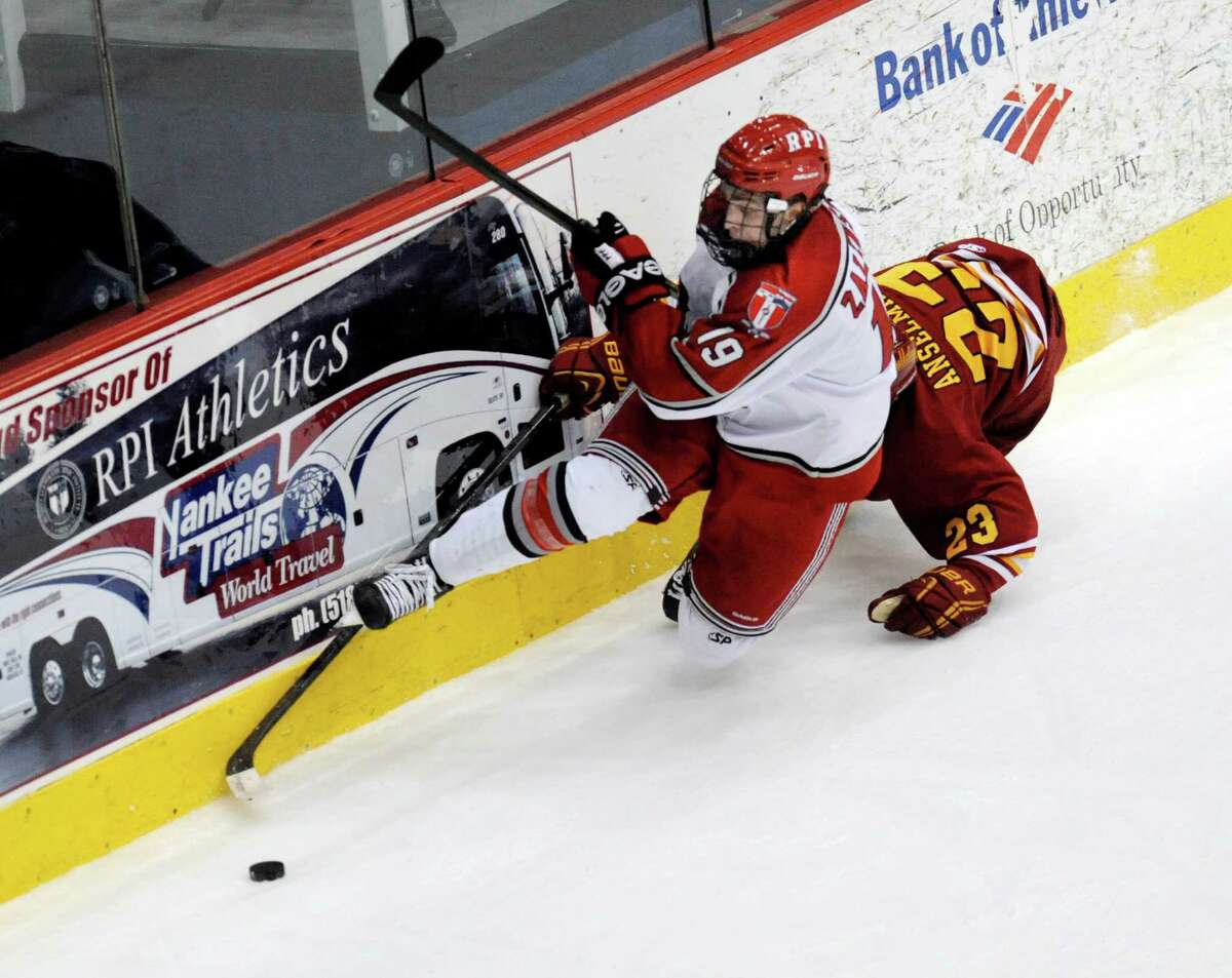 Rensselaer Polytechnic Institute's Mike Zalewski (19) checks Ferris State's Brandon Anselmini into the wall during their college hockey game in Troy N.Y., Friday, Oct. 12, 2012. (Hans Pennink / Special to the Times Union) College Sports.