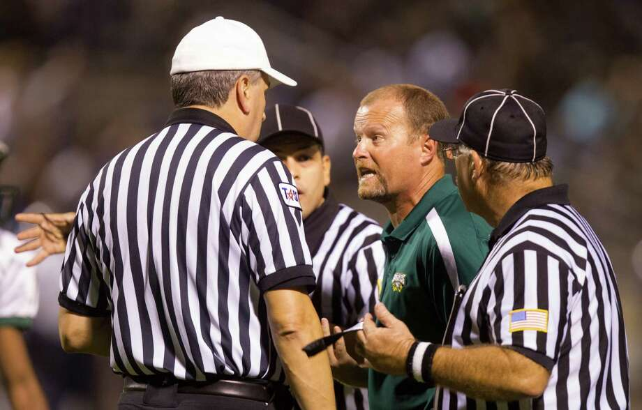 Cy Falls head football coach Kirk Eaton argues a play with the referees during the second quarter of a high school football game against Cy Ridge at Pridgeon stadium on Friday, Oct. 12, 2012, in Houston. Photo: J. Patric Schneider, For The Chronicle / © 2012 Houston Chronicle