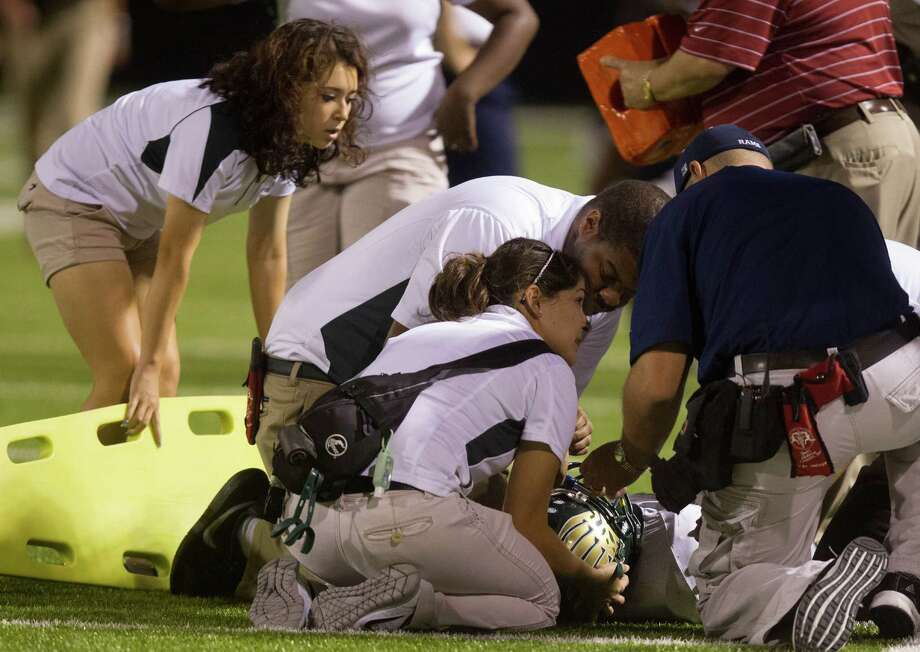 Cy Falls Leon Nyugen (9) is taken off the field by stretcher after an onside kick attempt by Cy Ridge.  Cy Falls defeated Cy Ridge 38-31 Photo: J. Patric Schneider, For The Chronicle / © 2012 Houston Chronicle