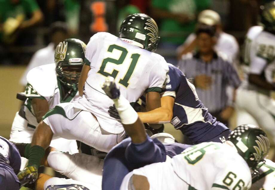Cy Falls' Bryce Peters scores a touchdown during the fourth quarter of a high school football game against Cy Ridge at Pridgeon stadium on Friday, Oct. 12, 2012, in Houston. Photo: J. Patric Schneider, For The Chronicle / © 2012 Houston Chronicle