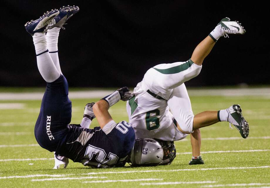 Cy Falls Leon Nyugen (9) and Cy Ridge Jacob Null (20) get upended on a play during the fourth quarter of a high school football game at Pridgeon stadium on Friday, Oct. 12, 2012, in Houston. Leon was taken off the field by stretcher several plays later on an onside kick attempt by Cy Ridge.  Cy Falls defeated Cy Ridge 38-31 Photo: J. Patric Schneider, For The Chronicle / © 2012 Houston Chronicle