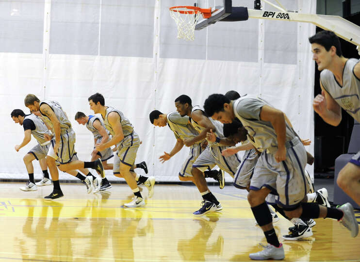 UAlbany basketball players warm up during the first practice of the season Friday, Oct. 12, 2012 in