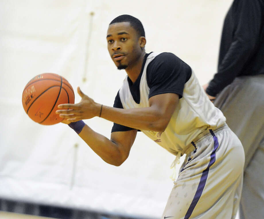 UAlbany basketball player Mike Black passes the ball during the first practice of the season Friday, Oct. 12, 2012 in Albany, N.Y. (Lori Van Buren / Times Union) Photo: Lori Van Buren