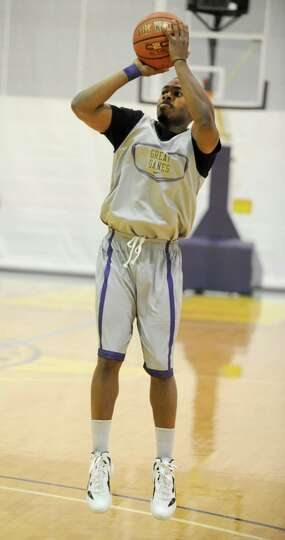 UAlbany basketball player Mike Black shoots the ball during the first practice of the season Friday,