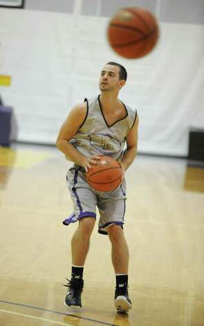 UAlbany basketball player Jacob Lati gets set to shoot the ball during the first practice of the season Friday, Oct. 12, 2012 in Albany, N.Y. (Lori Van Buren / Times Union) Photo: Lori Van Buren