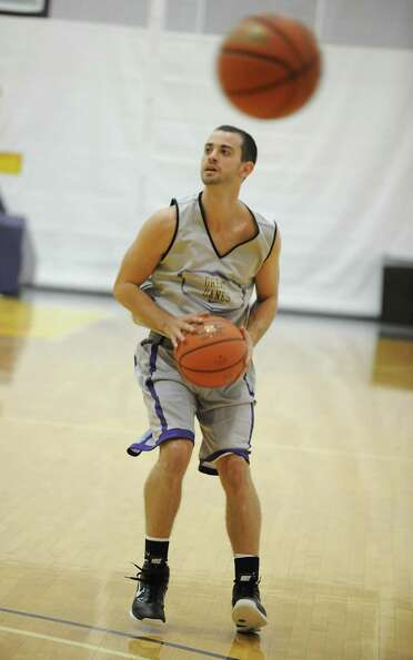 UAlbany basketball player Jacob Lati gets set to shoot the ball during the first practice of the sea