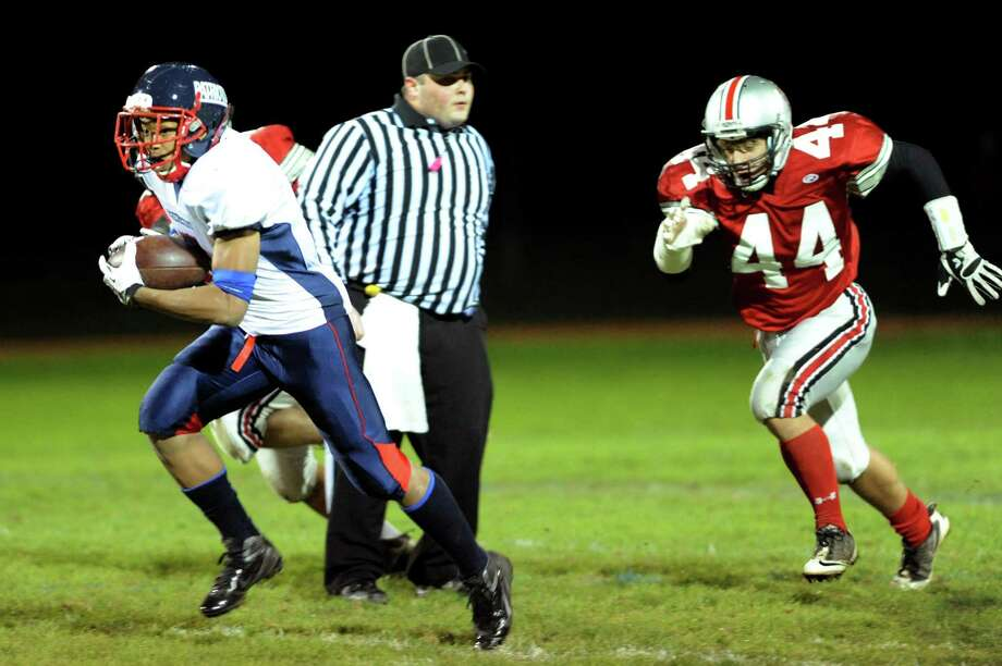 Schenectady's Hassan Rainey (7), left, runs the ball as Niskayuna's Nikko Sacks (44) gives chase during their football game on Friday, Oct. 12, 2012, at Niskayuna High in Niskayuna, N.Y. (Cindy Schultz / Times Union) Photo: Cindy Schultz / 00019607A