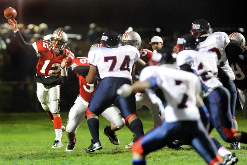 Niskayuna's quarterback Chris Herman (12), left, throws a pass during their football game against Sc