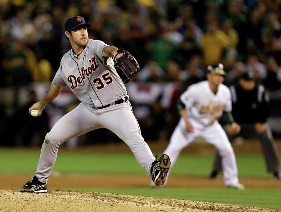 Detroit Tigers starting pitcher Justin Verlander delivers a pitch in the eighth inning of Game 5 of an American League division baseball series against the Oakland Athletics in Oakland, Calif., Thursday, Oct. 11, 2012. (AP Photo/Marcio Jose Sanchez) Photo: Marcio Jose Sanchez