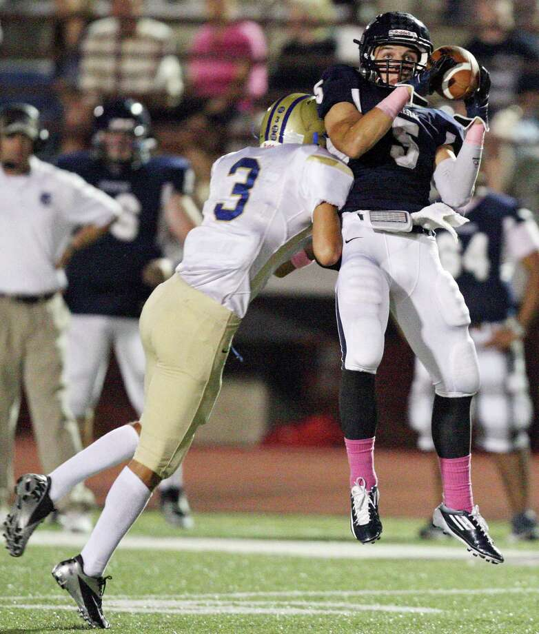 Boerne Champion's Michael Moloney is hit by Kerrville Tivy's Billy Field as he catches a pass during first half action Friday Oct. 12, 2012 at Boerne Independent School District Stadium in Boerne, TX. Photo: Edward A. Ornelas, Express-News / © 2012 San Antonio Express-News