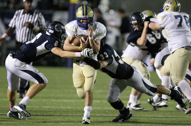 Kerrville Tivy's Parks McNeil looks for room between Boerne Champion's Dillion Manz (left) and Boerne Champion's Blake Webb during second half action Friday Oct. 12, 2012 at Boerne Independent School District Stadium in Boerne, TX.  Kerrville Tivy won 27-14. Photo: Edward A. Ornelas, Express-News / © 2012 San Antonio Express-News