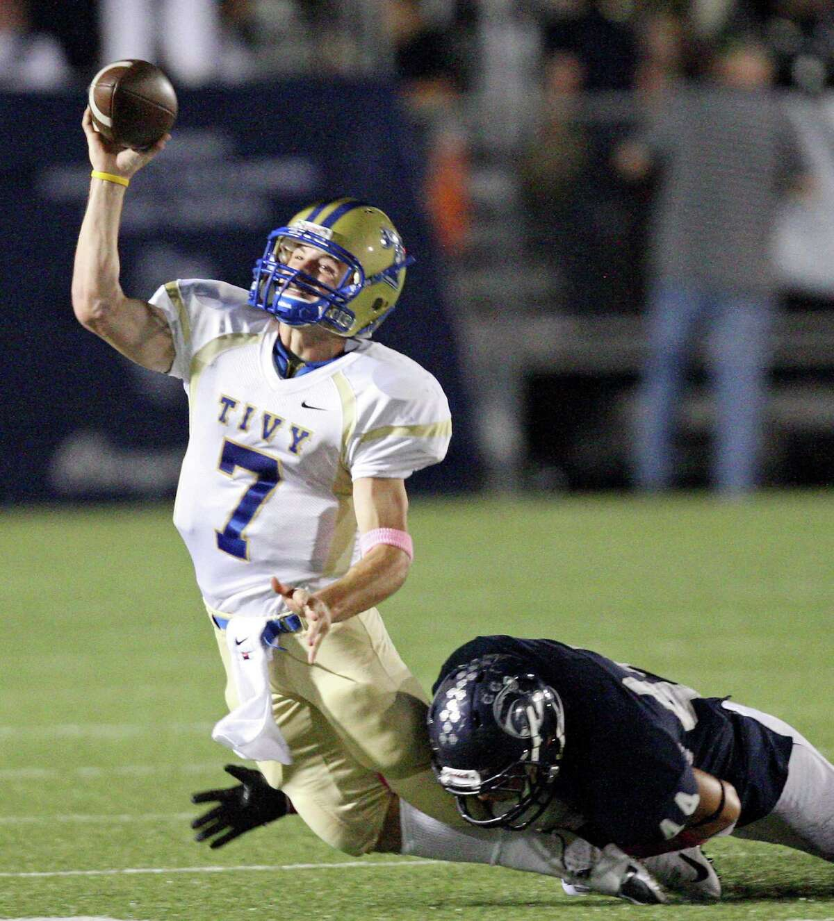 Kerrville Tivy's Parks McNeil passes under pressure from Boerne Champion's James Clarke during first half action Friday Oct. 12, 2012 at Boerne Independent School District Stadium in Boerne, TX.