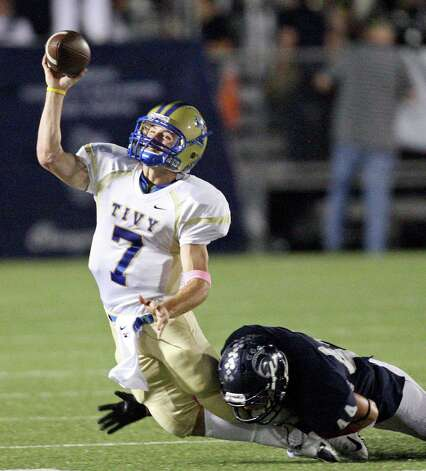 Kerrville Tivy's Parks McNeil passes under pressure from Boerne Champion's James Clarke during first half action Friday Oct. 12, 2012 at Boerne Independent School District Stadium in Boerne, TX. Photo: Edward A. Ornelas, Express-News / © 2012 San Antonio Express-News
