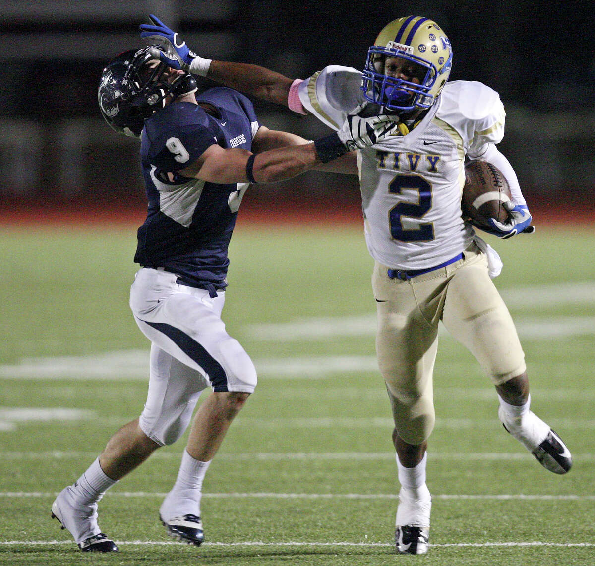 Kerrville Tivy's Will Stuckey stiff-arms Boerne Champion's Liam Brennan during first half action Friday Oct. 12, 2012 at Boerne Independent School District Stadium in Boerne, TX.