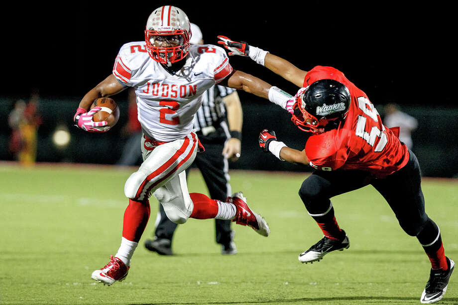 "Judson running back Jarveon Williams (left) tries to elude Wagner's Adeo Davis during the second quarter of their game at Rutledge Stadium on Oct. 12, 2012.  Judson won the ""Hammer Bowl"" 30-0.  MARVIN PFEIFFER/ mpfeiffer@express-news.net Photo: MARVIN PFEIFFER, Express-News / Express-News 2012"